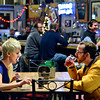 Caitlin Gibbons, left, of Denver, and Nate Wessel, of Longmont, enjoy a beer at Oskar Blues Tasty Weasel Tap Room in Longmont on Monday, Dec. 17, 2012.<br /> (Greg Lindstrom/Times-Call)