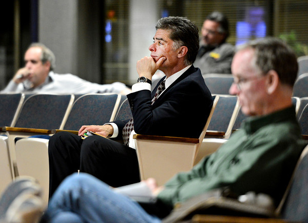 Allen Binsborg, managing partner for NewMark Merrill Mountain States, listens to discussion about the redevelopment of Twin Peaks Mall during Longmont City Council meeting on Tuesday, Feb. 5, 2013.<br /> (Greg Lindstrom/Times-Call)