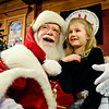 "Lauren Casey, 6, talks with Santa Claus during the ""Our Gift to the OUR Center"" toy drive at Left Hand Brewing Co. on Friday, Dec. 21, 2012. Casey and her family brought more than 100 toys to the event, many of which came from a celebration for Bernard ""Buzz"" Pearson that took place earlier in the day. Pearson, Casey's grandfather, passed away on Dec. 4. He was 68. The toys donated at Left Hand Brewing Co. will be delivered to the OUR Center on Christmas morning.<br /> (Greg Lindstrom/Times-Call)"