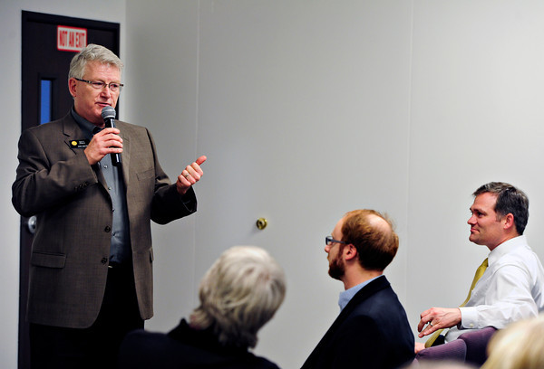 State Reps. Mike Foote, right, and Jonathan Singer, center, listen to discussion from State Sen. Matt Jones, left, during the Longmont Area Democrats' meeting at Front Range Community College in Longmont on Wednesday, March 6, 2013.<br /> (Greg Lindstrom/Times-Call)