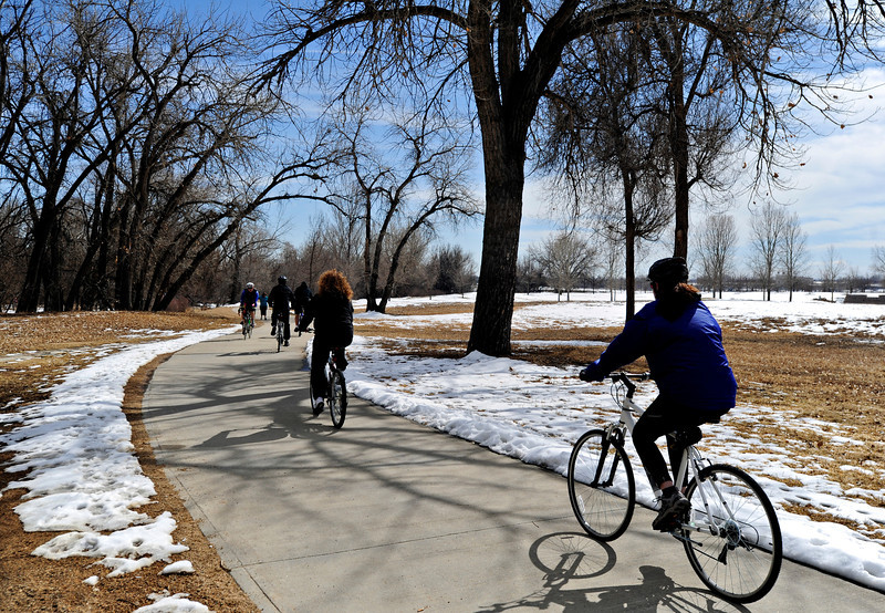 Cyclists ride along the St. Vrain Greenway through Rogers Grove in Longmont on Saturday, March 2, 2013.<br /> (Greg Lindstrom/Times-Call)