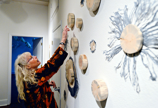 """Jill Powers points to blue-dyed wood as she presents work in """"Plants and Insects in a Time of Change,"""" a new exhibit at Firehouse Art Center in Longmont on Monday, Jan. 21, 2013. <br /> (Greg Lindstrom/Times-Call)"""