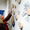 "Jill Powers points to blue-dyed wood as she presents work in ""Plants and Insects in a Time of Change,"" a new exhibit at Firehouse Art Center in Longmont on Monday, Jan. 21, 2013. <br /> (Greg Lindstrom/Times-Call)"
