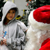"Saul Corneleo, 9, visits with Santa Claus during the annual Y-Pals Holiday Party and Longmont Bicycle Giveaway at the Ed & Ruth Lehman YMCA, 950 Lashley St., Saturday Dec. 15, 2012. TO VIEW A VIDEO AND SLIDESHOW VISIT  <a href=""http://WWW.TIMESCALL.COM"">http://WWW.TIMESCALL.COM</a> (Lewis Geyer/Times-Call)"