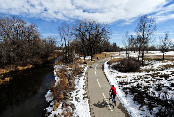 A cyclist rides along the St. Vrain Greenway through Rogers Grove in Longmont on Saturday, March 2, 2013.<br /> (Greg Lindstrom/Times-Call)