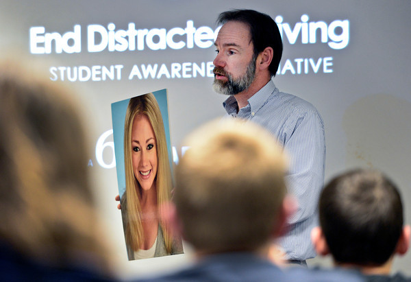 Guest speaker Joel Feldman holds a picture of his daughter, Casey, while he discusses the dangers of distracted driving during a driver education class at Longmont High School on Wednesday, Jan. 9, 2013. Casey was killed by a distracted driver in 2009.<br /> (Greg Lindstrom/Times-Call)