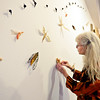 "Jill Powers adjusts an insect, made out of kozo bark fiber, as she presents work in ""Plants and Insects in a Time of Change,"" a new exhibit at Firehouse Art Center in Longmont on Monday, Jan. 21, 2013. <br /> (Greg Lindstrom/Times-Call)"