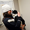 Melissa Park hugs her cat, Smaug, who went missing more than two years ago, while picking him up at the Longmont Humane Society  on Wednesday, Nov. 28, 2012.  Earlier this week, a Longmont couple brought the cat to the Longmont Humane Society.  Staff were able to scan Smaug's microchip and reunite the cat with his owners.  Park said she plans to drive the cat to her now ex-husband's home in Seattle, where the cat will likely live.<br /> (Greg Lindstrom/Times-Call)