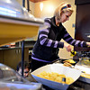 Sherry Sizemore dishes up dinner at the Marriott Residence Inn, 1450 Dry Creek Drive in Longmont, on Wednesday, Feb. 27, 2013.<br /> (Greg Lindstrom/Times-Call)