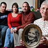 Darlene Allen, right, holds a picture of her deceased daughter, Mary Ann Bryan, while posing for a portrait with her family, left to right, Rick Deeter, Jenifer Deeter and Dan Bryan on Thursday, Jan. 10, 2013. <br /> (Greg Lindstrom/Times-Call)