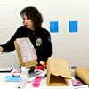 Longmont Police Department evidence technician Dawn Cavins shows items recovered from multiple shopliftings at Walmart at the Safety and Justice Center in Longmont on Tuesday, Feb. 12, 2013. <br /> (Greg Lindstrom/Times-Call)