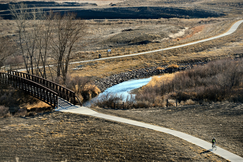 A cyclist rides along the St. Vrain Greenway near Sandstone Ranch in Longmont on Friday, Feb. 8, 2013. <br /> (Greg Lindstrom/Times-Call)