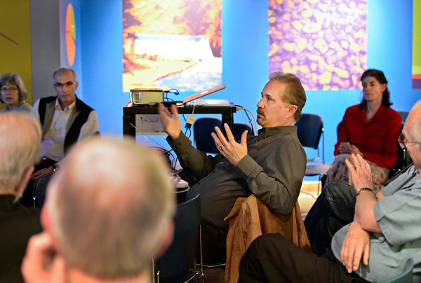 Tom Roiniotis, center, executive director for Longmont Power and Communications, answers questions from audience members at the Longmont Museum & Cultural Center on Thursday, Feb. 7, 2013. <br /> (Greg Lindstrom/Times-Call)