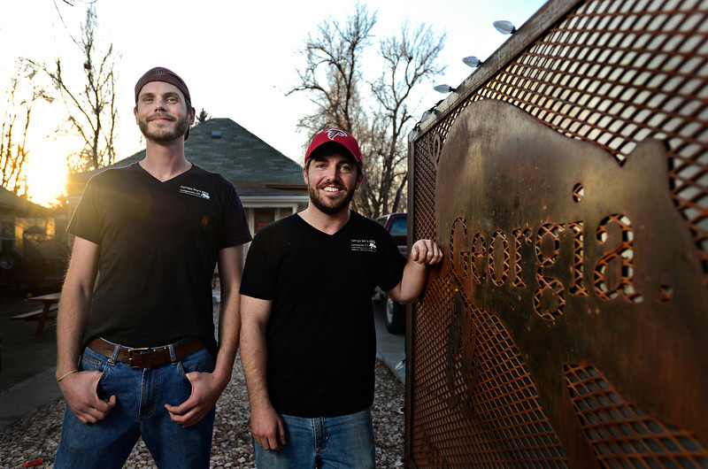 Nick Reckinger, left, and Matt Alexander are pictured outside Georgia boys BBQ, 237 Collyer St., in Longmont on Friday, Feb. 8, 2013. <br /> (Greg Lindstrom/Times-Call)