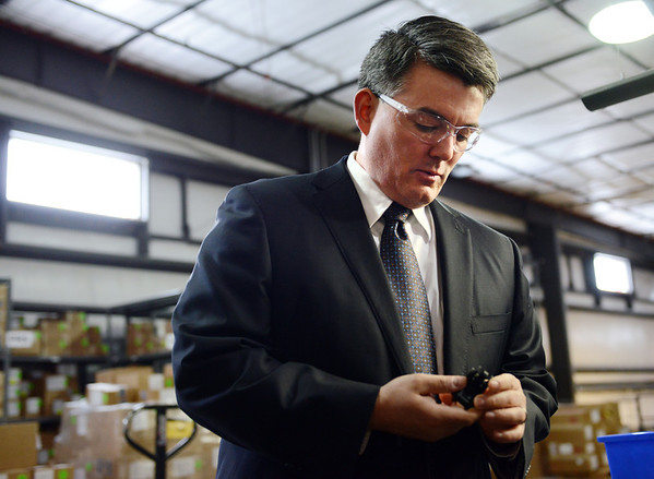 U.S. Rep. Cory Gardner, R-Yuma, looks at a product made at Magpul Industries Corp., in Erie, while touring the company Thursday morning Feb. 21, 2013. Magpul, a gun parts manufacturer, has threatened to leave Colorado if there is a law passed limiting the capacity of ammunition magazines. (Lewis Geyer/Times-Call)