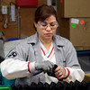 Employee Zonia Talacios cleans a plastic gun stock product at Magpul Industries Corp., in Erie, Thursday morning Feb. 21, 2013. Magpul, a gun parts manufacturer, has threatened to leave Colorado if the state passes a law limiting the capacity of ammunition magazines. (Lewis Geyer/Times-Call)