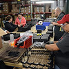 Nancy Martinez, right, assembles springs for ammunition clips at Magpul Industries Corp., in Erie, Thursday morning Feb. 21, 2013. (Lewis Geyer/Times-Call)