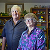 Martha and Conrad Hopp of Longmont pose in front of their tractor collection in their home Wednesday, Oct. 3, 2012. The Hopps have been married for 55 years and have been collecting tractors since 1989. (Elaine Cromie/For the Times-Call)