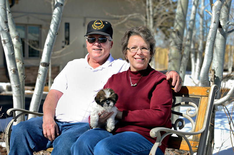 Bob and DiAnn Wayland are pictured with Miley, their 8-week-old Shih Tzu, outside Bible Baptist Church of Erie on Saturday, March 2, 2013.<br /> (Greg Lindstrom/Times-Call)