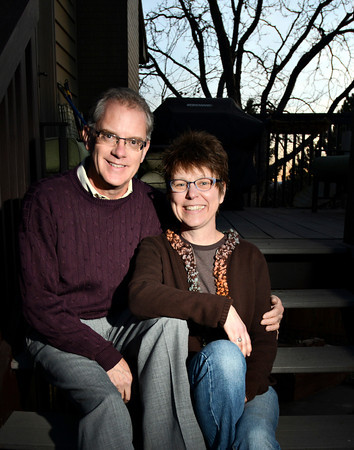 Ken Hutchison and his wife Tanya Morrow are pictured at their Longmont home on Tuesday, Jan. 8, 2013. <br /> (Greg Lindstrom/Times-Call)