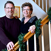 Lisa and Jack Truesdale, who will celebrate 19 years of marriage this May, have built a relationship on their mutual passion for sports. They are pictured in their Longmont home on Monday, Feb. 11, 2013. <br /> (Greg Lindstrom/Times-Call)