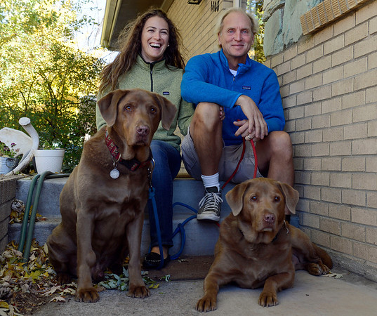 Alicia and Larry Houchen, of Longmont, with their chocolate labs Huck and Tom Wednesday Oct. 17, 2012.  (Lewis Geyer/Times-Call)