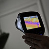 Nikki Chandler, of Ultimate Properties and Development, uses an infrared camera to inspect a home during an energy audit, Tuesday, Jan. 15, 2013, in Longmont. Blue and purple area represent the presence of cold air and are used to determine gaps in the insulation.<br /> (Matthew Jonas/Times-Call)