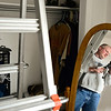 Home owner Matthew Kenworthy looks at flash light found in his attic by Nikki Chandler, of Ultimate Properties and Development, (not pictured) as she was conducting an energy audit, Tuesday, Jan. 15, 2013, in Longmont.<br /> (Matthew Jonas/Times-Call)