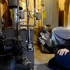 Nikki Chandler, of Ultimate Properties and Development, inspects a furnace while conducting an energy audit, Tuesday, Jan. 15, 2013, at a home in Longmont.<br /> (Matthew Jonas/Times-Call)