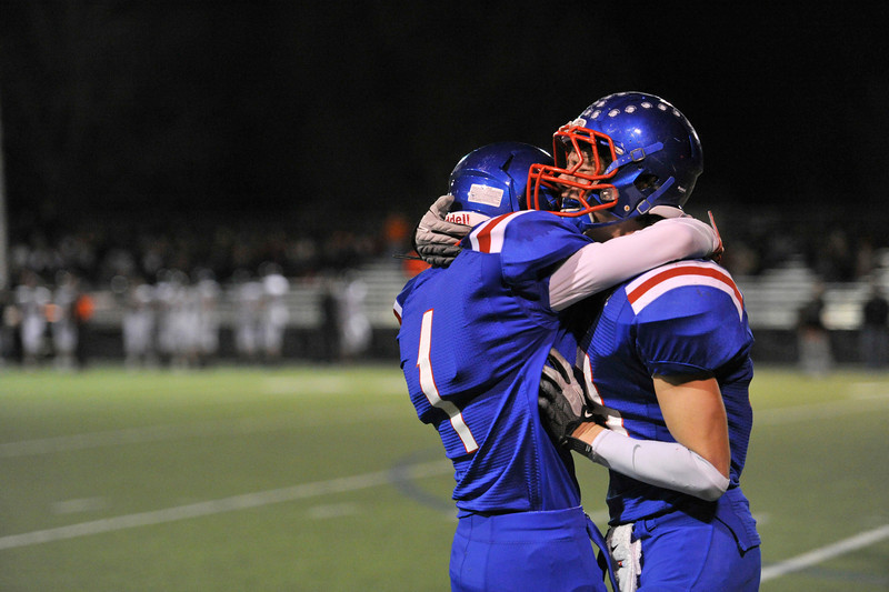 Centaurus High School's Ryan Sepena (No. 43) is overcome with emotion as he hugs teammate Matthew Wright (No.1) after scoring a touchdown against Erie High School during the fourth quarter, Friday, Nov. 2, 2012, at CHS. The Tigers defeated the Warriors, 37-20.<br /> (Matthew Jonas/Times-Call)