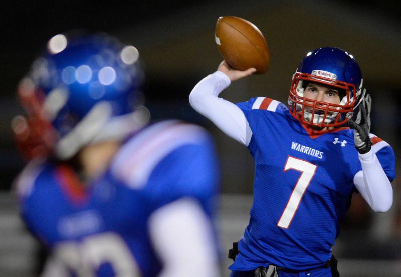 Centaurus High School's John Howard (No. 7) passes against Erie High School during the first quarter, Friday, Nov. 2, 2012, at CHS.<br /> (Matthew Jonas/Times-Call)