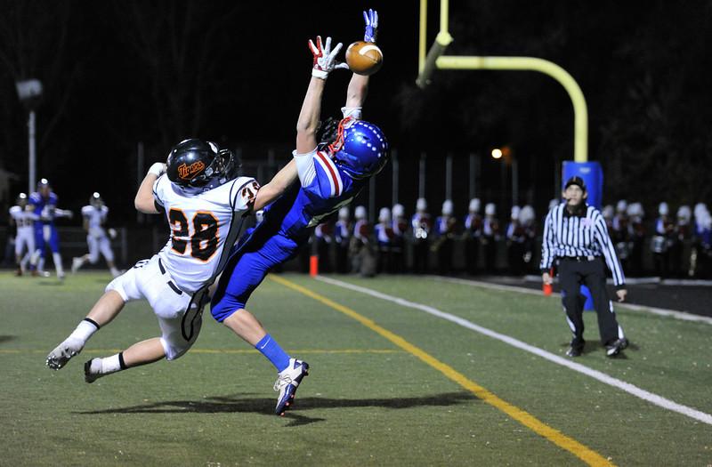 Erie High School's Joey Ramey (No. 28) breaks up a pass to Centaurus High School's Brody Jaskul (No. 25) during the second quarter, Friday, Nov. 2, 2012, at CHS.<br /> (Matthew Jonas/Times-Call)