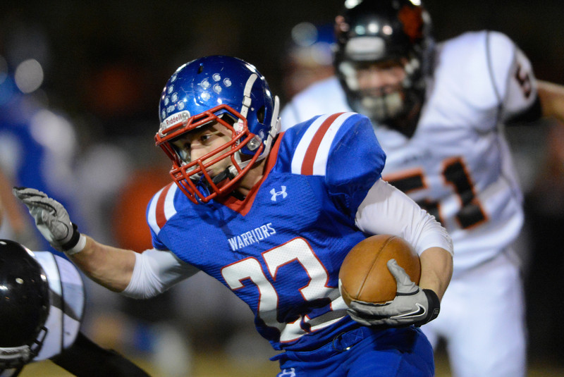 Centaurus High School's Tanner Martinelli (No. 23) tries to push his way through Erie High School's defense during the first quarter, Friday, Nov. 2, 2012, at CHS.<br /> (Matthew Jonas/Times-Call)