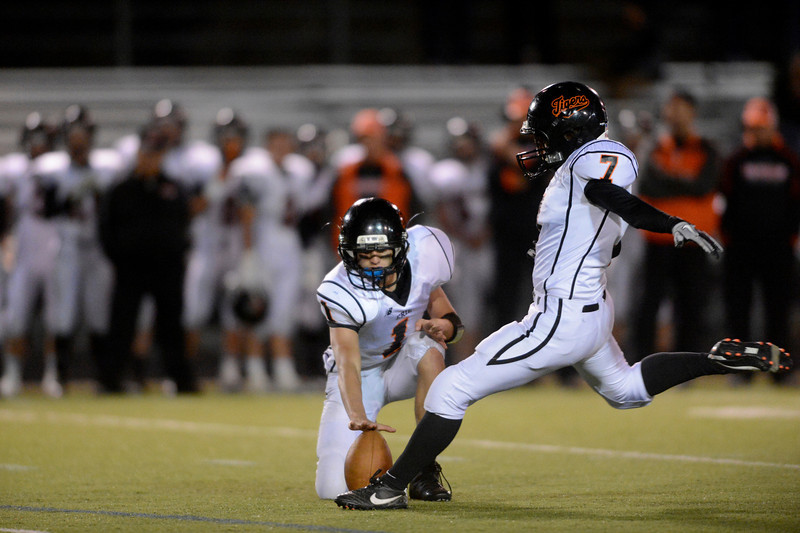 Erie High School's Ethan Mezler (No. 7) kicks a 32 yard field goal against Centaurus High School during the fourth quarter, Friday, Nov. 2, 2012, at CHS. The Tigers defeated the Warriors, 37-20.<br /> (Matthew Jonas/Times-Call)