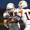 "Mead's Griffin Nelson (17) hands off to Kyle Couch (2) in the first half. Erie beat Mead 24-0 on Friday, Sept. 21, 2012.  For more photos visit  <a href=""http://www.BoCoPreps.com"">http://www.BoCoPreps.com</a>.<br /> (Greg Lindstrom/Times-Call)"