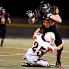"""Erie's Kody Dotson (80) runs over Mead's Nick Staiano (25) in the first half.  Erie beat Mead 24-0 on Friday, Sept. 21, 2012.  For more photos visit  <a href=""""http://www.BoCoPreps.com"""">http://www.BoCoPreps.com</a>.<br /> (Greg Lindstrom/Times-Call)"""