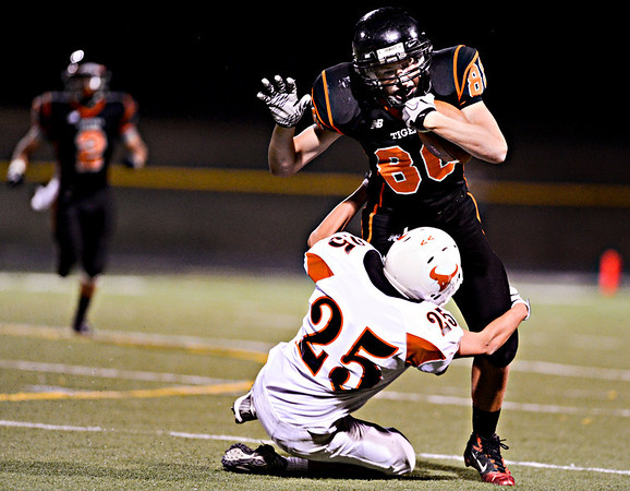 "Erie's Kody Dotson (80) runs over Mead's Nick Staiano (25) in the first half.  Erie beat Mead 24-0 on Friday, Sept. 21, 2012.  For more photos visit  <a href=""http://www.BoCoPreps.com"">http://www.BoCoPreps.com</a>.<br /> (Greg Lindstrom/Times-Call)"