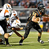 """Erie's Ryne Atkins (46) looks for a gap in the Mead defense in the first half.  Erie beat Mead 24-0 on Friday, Sept. 21, 2012.  For more photos visit  <a href=""""http://www.BoCoPreps.com"""">http://www.BoCoPreps.com</a>.<br /> (Greg Lindstrom/Times-Call)"""