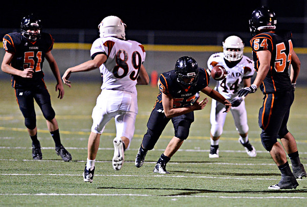 """Erie's Max Dixon (53) tries to control a bouncing punt in the first half.  Erie beat Mead 24-0 on Friday, Sept. 21, 2012.  For more photos visit  <a href=""""http://www.BoCoPreps.com"""">http://www.BoCoPreps.com</a>.<br /> (Greg Lindstrom/Times-Call)"""