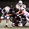 """Erie's B.J. Jensen powers through the Mead defense near the goal line, setting up a Tiger touchdown in the second quarter. Erie beat Mead 24-0 on Friday, Sept. 21, 2012.  For more photos visit  <a href=""""http://www.BoCoPreps.com"""">http://www.BoCoPreps.com</a>.<br /> (Greg Lindstrom/Times-Call)"""