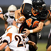 """Erie's Ryne Atkins (46) runs past Mead's Nick Staiano (25) in the first half. Erie beat Mead 24-0 on Friday, Sept. 21, 2012.  For more photos visit  <a href=""""http://www.BoCoPreps.com"""">http://www.BoCoPreps.com</a>.<br /> (Greg Lindstrom/Times-Call)"""