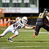 "Erie's Christian Mickey (21) runs around Mead's Vaughn Anderson (89) as he returns a punt for a touchdown.  Erie beat Mead 24-0 on Friday, Sept. 21, 2012.  For more photos visit  <a href=""http://www.BoCoPreps.com"">http://www.BoCoPreps.com</a>.<br /> (Greg Lindstrom/Times-Call)"