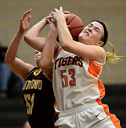 """Erie's Piper Zeier (53) competes for a rebound with Berthoud's Taylor Armitage (51) during the game at Erie High School on Thursday, Dec. 20, 2012. Erie beat Berthoud 30-27. For more photos visit  <a href=""""http://www.BoCoPreps.com"""">http://www.BoCoPreps.com</a>.<br /> (Greg Lindstrom/Times-Call)"""
