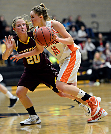 "Erie's Amanda Ochoa (10) tries to drive past Berthoud's Kendall Baker (20) during the game at Erie High School on Thursday, Dec. 20, 2012. Erie beat Berthoud 30-27. For more photos visit  <a href=""http://www.BoCoPreps.com"">http://www.BoCoPreps.com</a>.<br /> (Greg Lindstrom/Times-Call)"