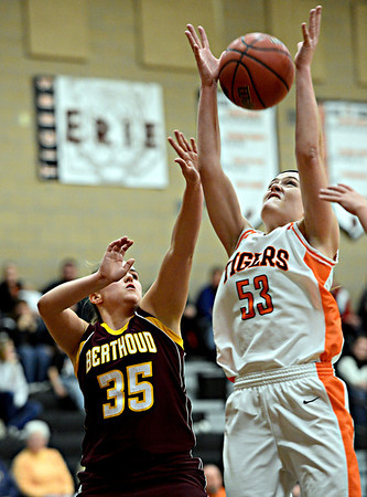 "Erie's Piper Zeier (53) grabs a rebound over Berthoud's Lindsey Karlin (35) during the game at Erie High School on Thursday, Dec. 20, 2012. Erie beat Berthoud 30-27. For more photos visit  <a href=""http://www.BoCoPreps.com"">http://www.BoCoPreps.com</a>.<br /> (Greg Lindstrom/Times-Call)"