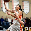 "Erie's Serena Gudino (23) goes up for a shot over Berthoud's Hannah Haggas (25) during the game at Erie High School on Thursday, Dec. 20, 2012. Erie beat Berthoud 30-27. For more photos visit  <a href=""http://www.BoCoPreps.com"">http://www.BoCoPreps.com</a>.<br /> (Greg Lindstrom/Times-Call)"
