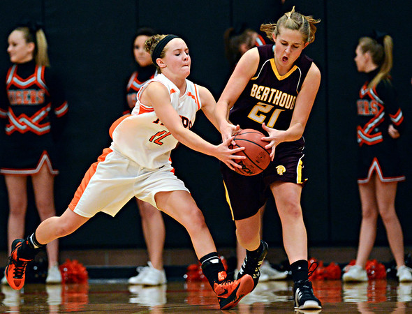 "Erie's Kenzie Kudrna (12) goes for a steal against Berthoud's Lindsey Loberg (21) during the game at Erie High School on Thursday, Dec. 20, 2012. Erie beat Berthoud 30-27. For more photos visit  <a href=""http://www.BoCoPreps.com"">http://www.BoCoPreps.com</a>.<br /> (Greg Lindstrom/Times-Call)"