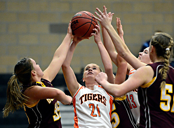 """Erie's Alyson Romey (21) tries to secure a rebound during the game at Erie High School on Thursday, Dec. 20, 2012. Erie beat Berthoud 30-27. For more photos visit  <a href=""""http://www.BoCoPreps.com"""">http://www.BoCoPreps.com</a>.<br /> (Greg Lindstrom/Times-Call)"""