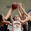 "Erie's Alyson Romey (21) tries to secure a rebound during the game at Erie High School on Thursday, Dec. 20, 2012. Erie beat Berthoud 30-27. For more photos visit  <a href=""http://www.BoCoPreps.com"">http://www.BoCoPreps.com</a>.<br /> (Greg Lindstrom/Times-Call)"