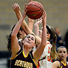 "Berthoud's Taylor Armitage (51) grabs a rebound over Erie's Piper Zeier, right, and Serena Gudino during the game at Erie High School on Thursday, Dec. 20, 2012. Erie beat Berthoud 30-27. For more photos visit  <a href=""http://www.BoCoPreps.com"">http://www.BoCoPreps.com</a>.<br /> (Greg Lindstrom/Times-Call)"